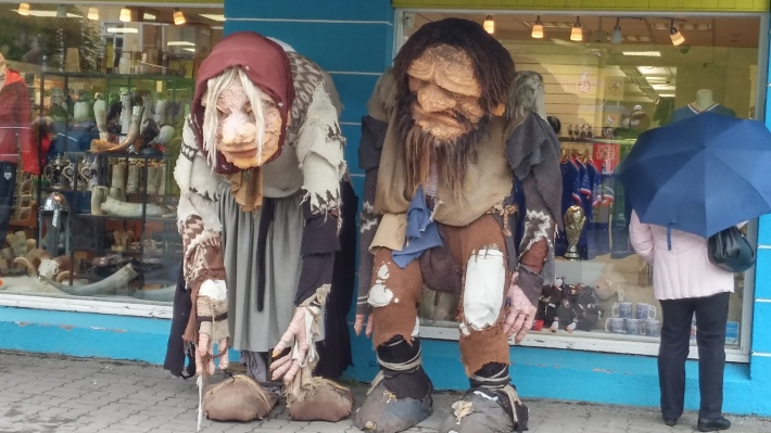 Trolls outside camping shop