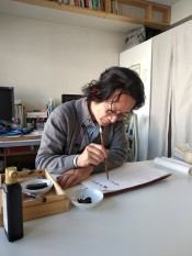 Aki does calligraphy for us