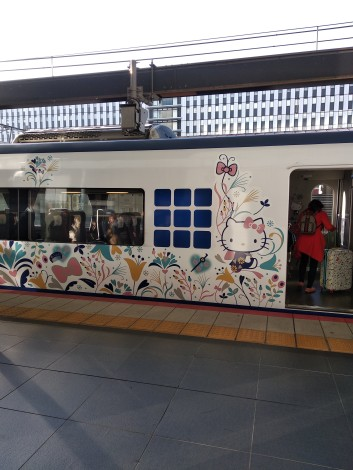 Hello Kitty train glimpsed at station